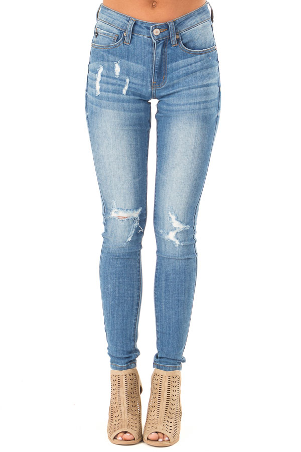 Medium Wash Mid Rise Skinny Jeans with Distressed Details front view