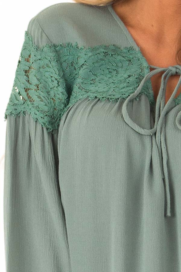 Emerald Long Sleeve Top with Front Tie and Lace Detail detail