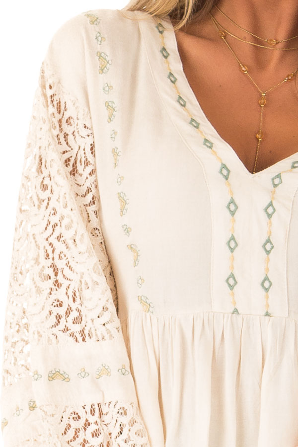 Cream Embroidered V Neck Blouse with Sheer Lace Detail detail