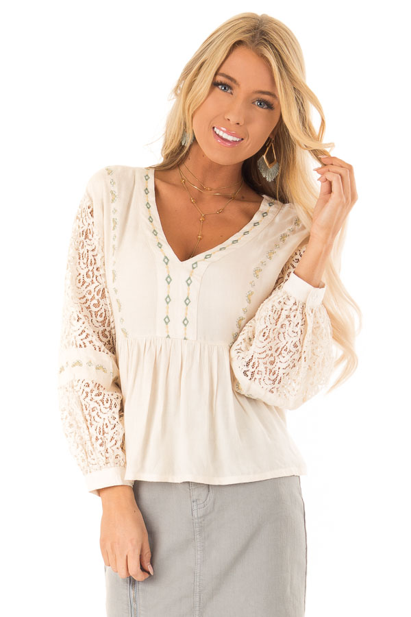 Cream Embroidered V Neck Blouse with Sheer Lace Detail front close up