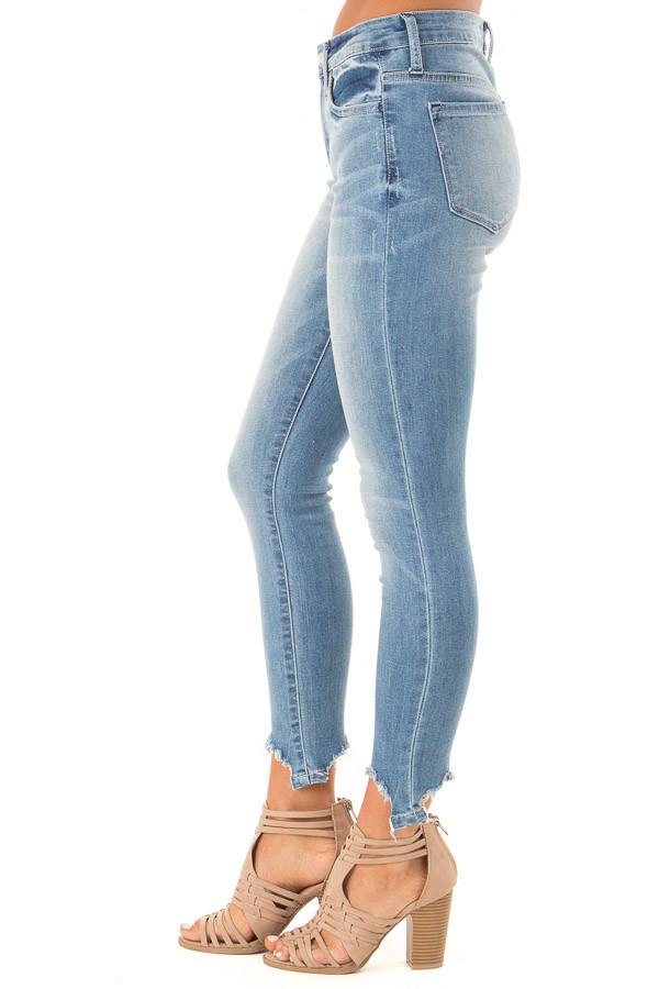 Medium Wash Mid Rise Skinny Jeans with Destroyed Hemline side view
