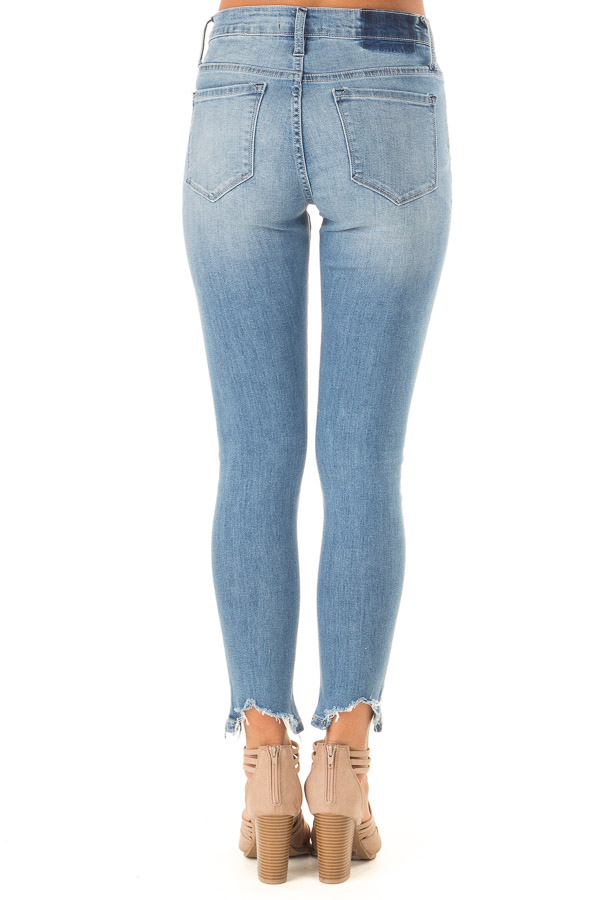 Medium Wash Mid Rise Skinny Jeans with Destroyed Hemline back view