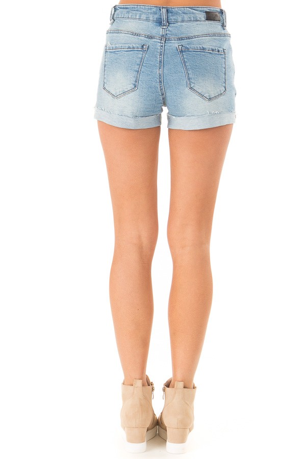 Light Wash Mid Rise Cuffed Shorts with Raw Hem back view