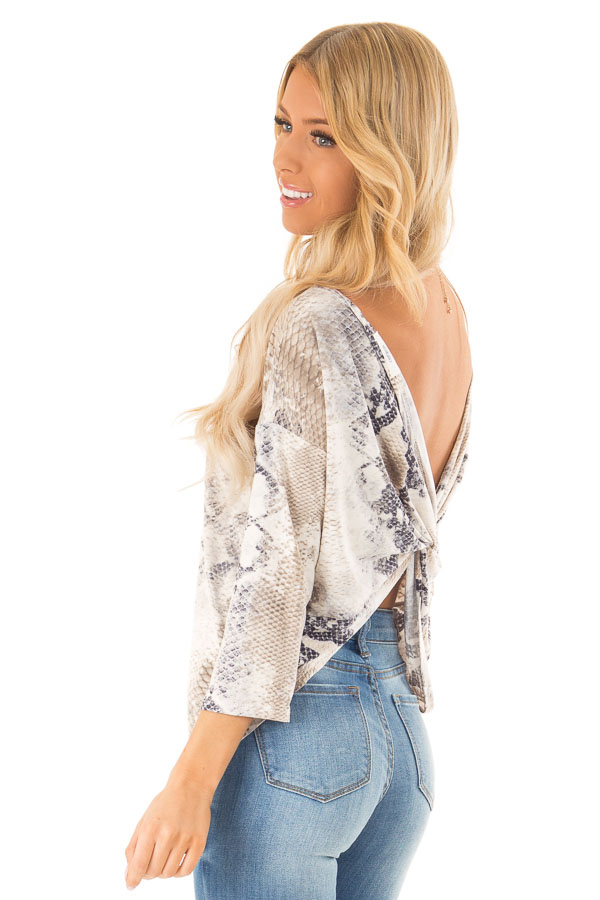 2afc7d5c276350 Taupe Snake Skin 3/4 Sleeve Top with V Back and Twist back side close