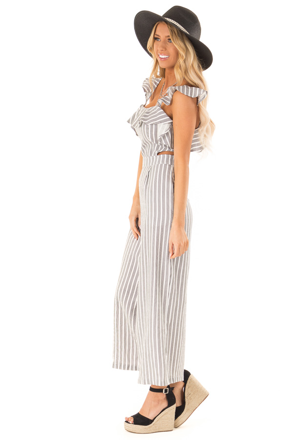 Black and Ivory Striped Ruffled Jumpsuit with Side Cutouts side full body