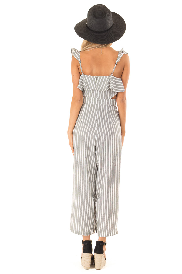 Black and Ivory Striped Ruffled Jumpsuit with Side Cutouts back full body