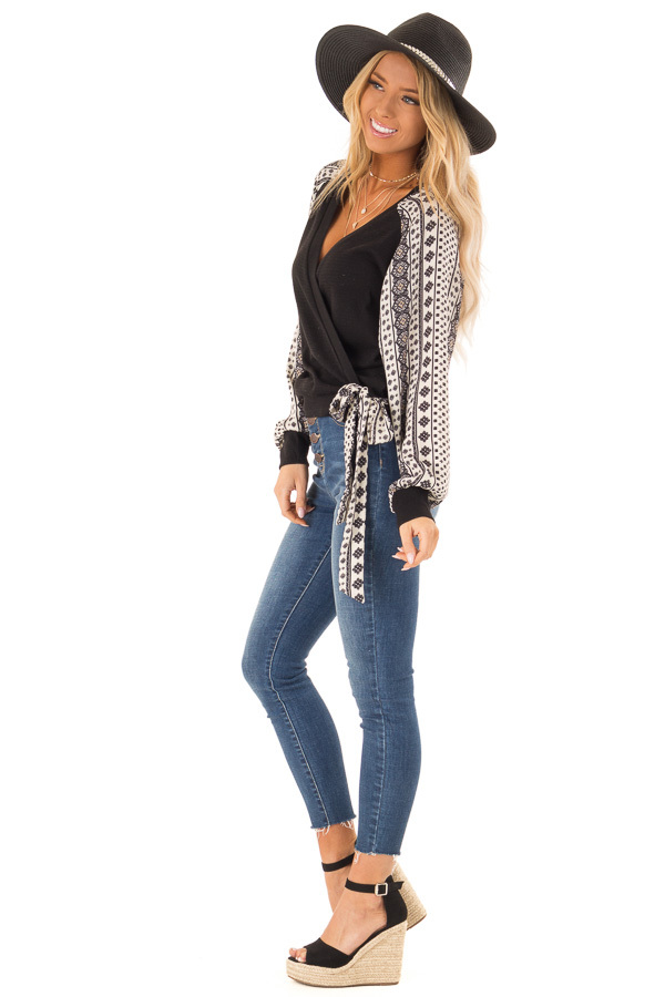 Black Wrap Style V Neck Top with Long Patterned Puff Sleeves side full body