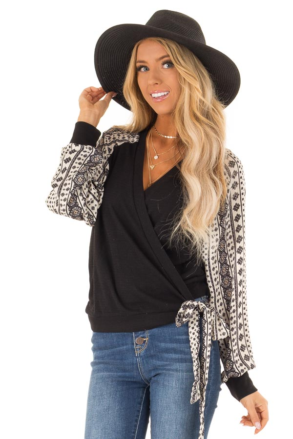Black Wrap Style V Neck Top with Long Patterned Puff Sleeves front close up