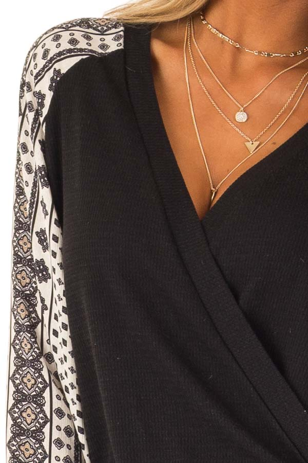 Black Wrap Style V Neck Top with Long Patterned Puff Sleeves detail