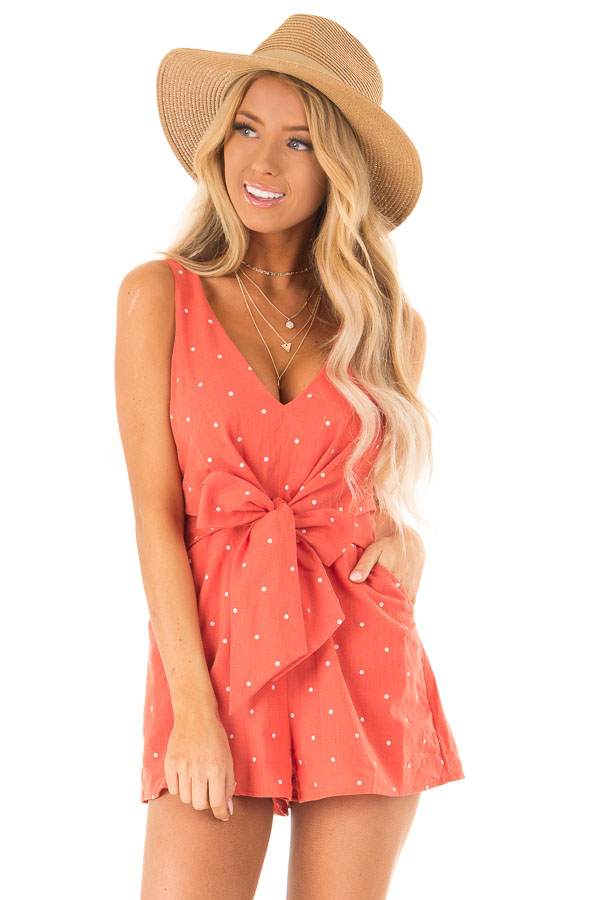 Tangerine Sleeveless Polka Dot Romper with Front Bow Tie front close up