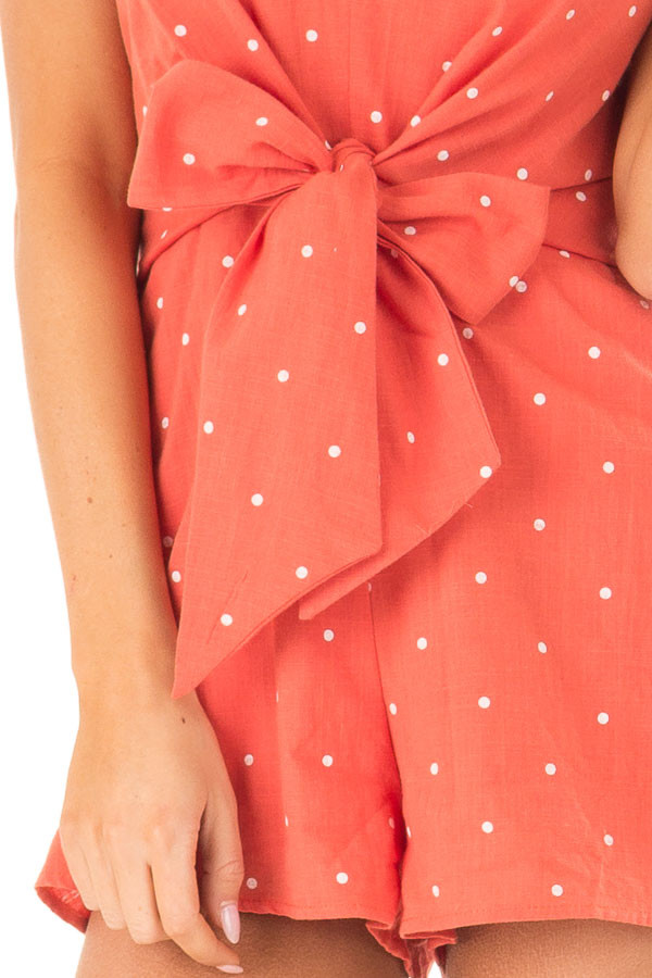 Tangerine Sleeveless Polka Dot Romper with Front Bow Tie detail