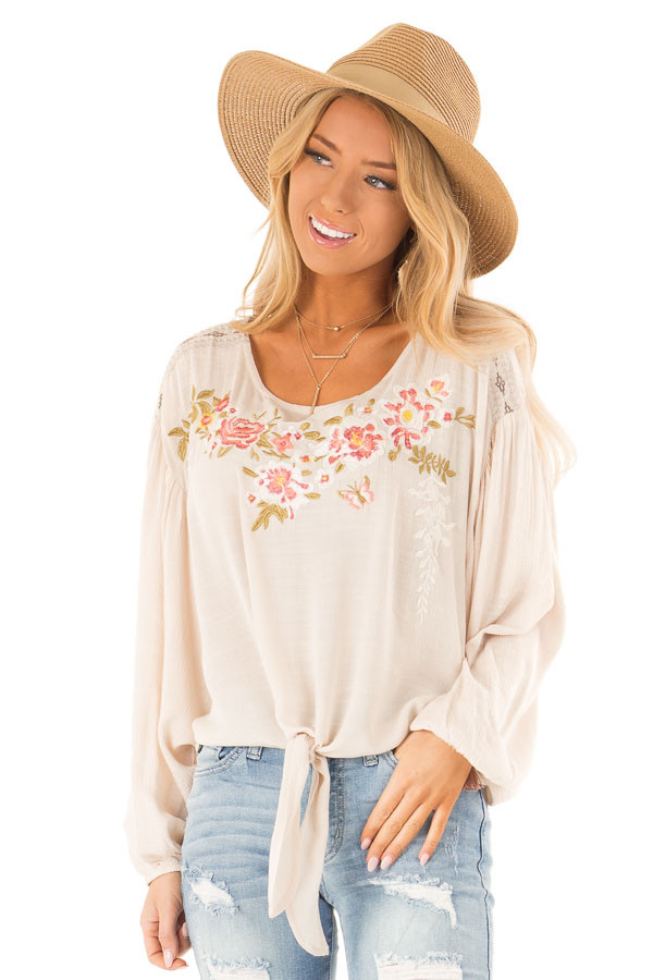 Oatmeal Peasant Top with Front Tie and Floral Embroidery front close up