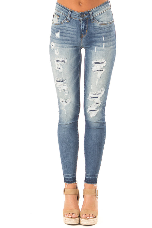 Medium Wash Denim Skinny Jeans with Distressed Details front view