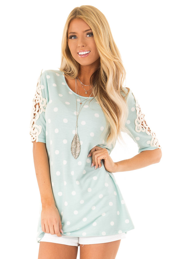 Sky Blue Polka Dot Top with Sheer Lace Sleeve Detail front close up