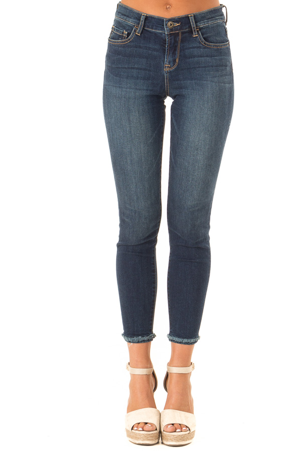 Dark Denim Mid Rise Ankle Skinny Jeans with Distressed Hems front view