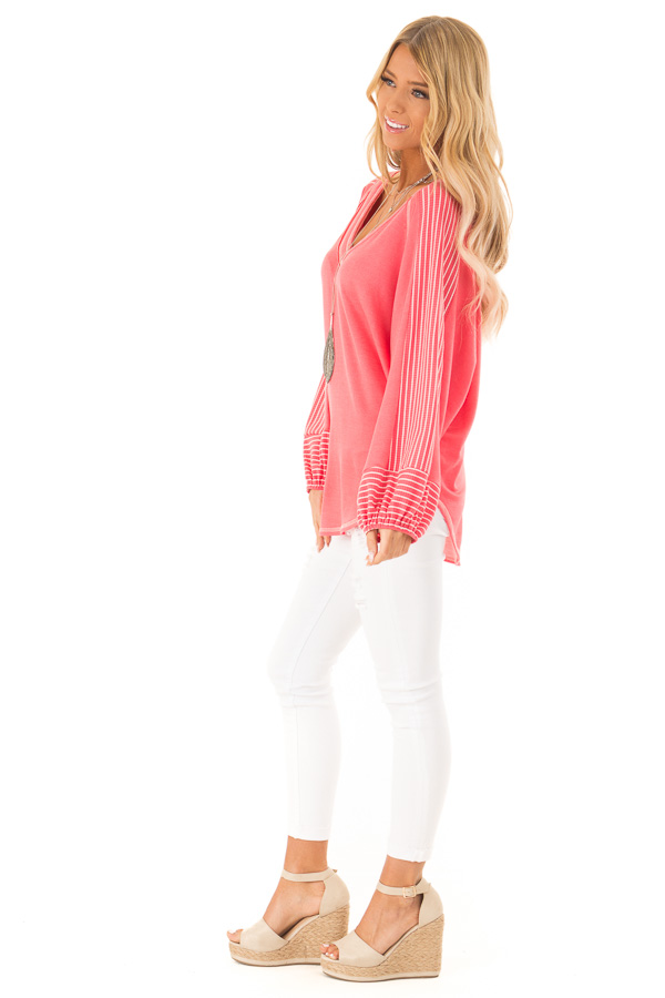 Coral V Neck Top with Contrasting Striped Long Sleeves side full body