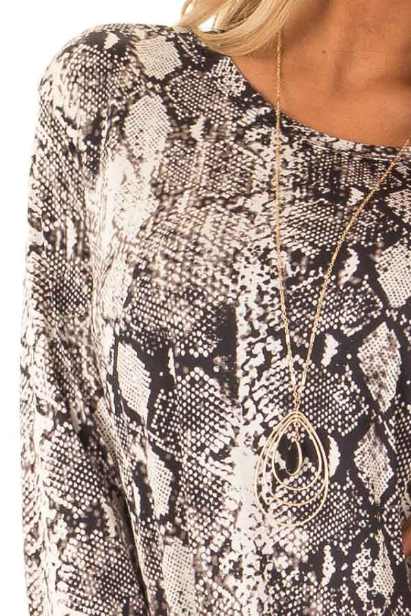 Obsidian and Ivory Snake Print Top with Twist Detail detail