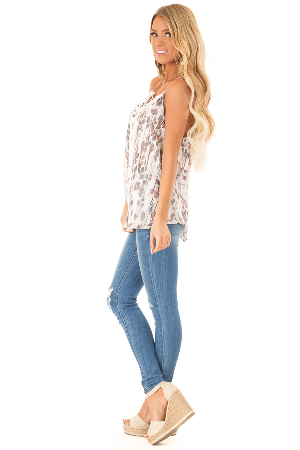 Ivory Sleeveless Criss Cross Floral Blouse with Lace Detail side full body