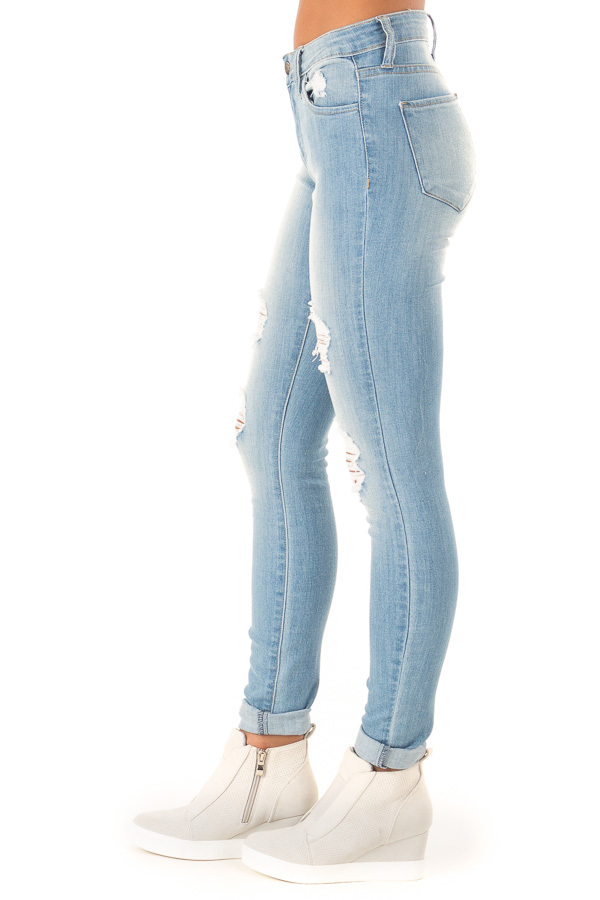 Light Wash Distressed Skinny Jeans with Cuffed Hemline side view