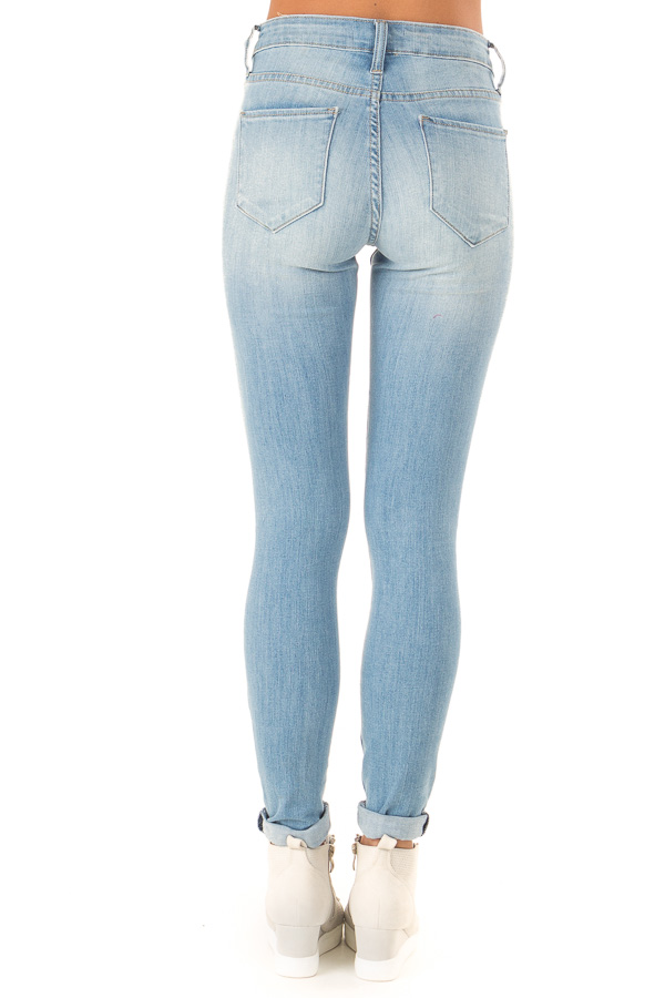 Light Wash Distressed Skinny Jeans with Cuffed Hemline back view