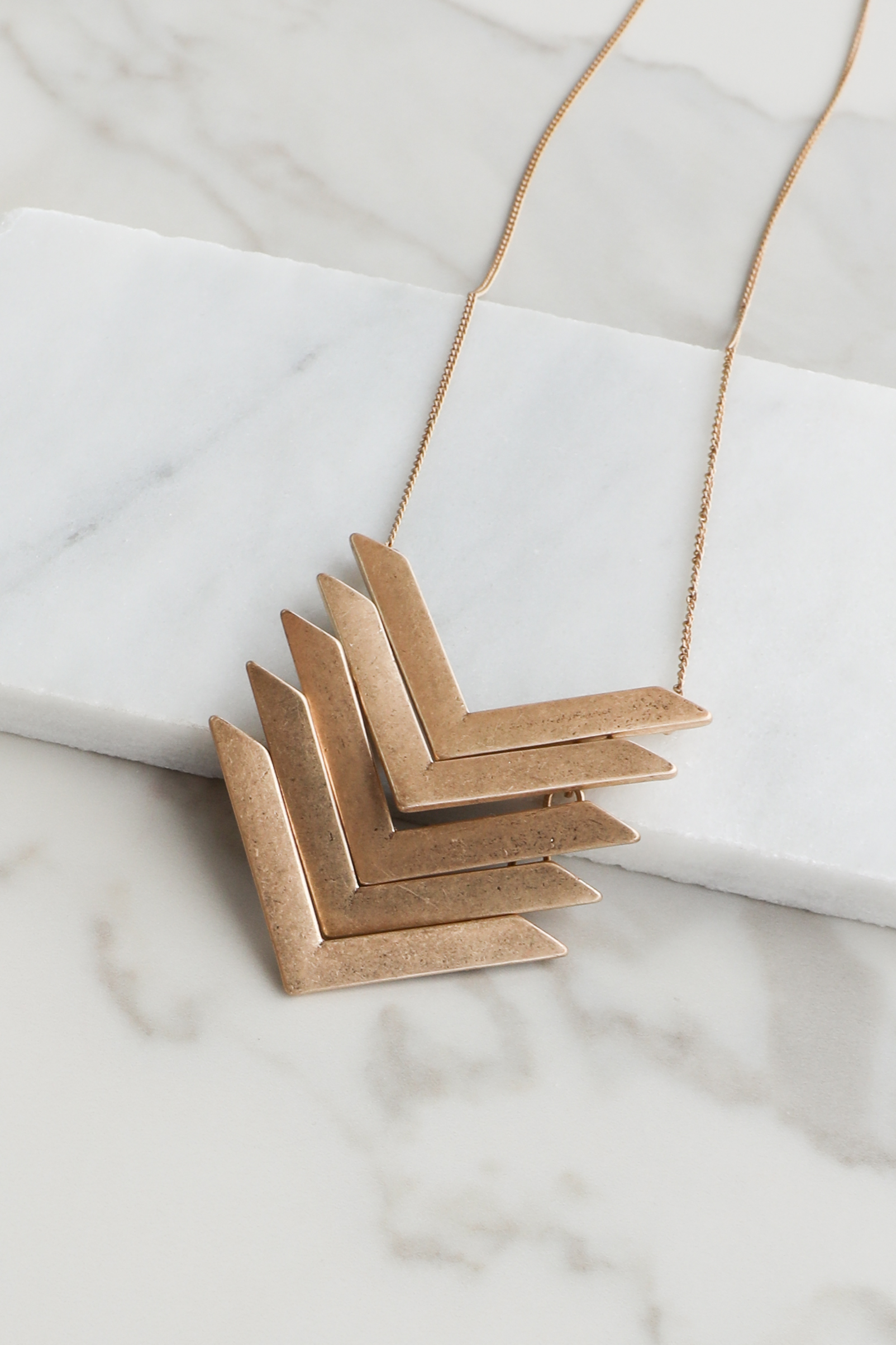 Gold Necklace with Layered Chevron Print Pendant