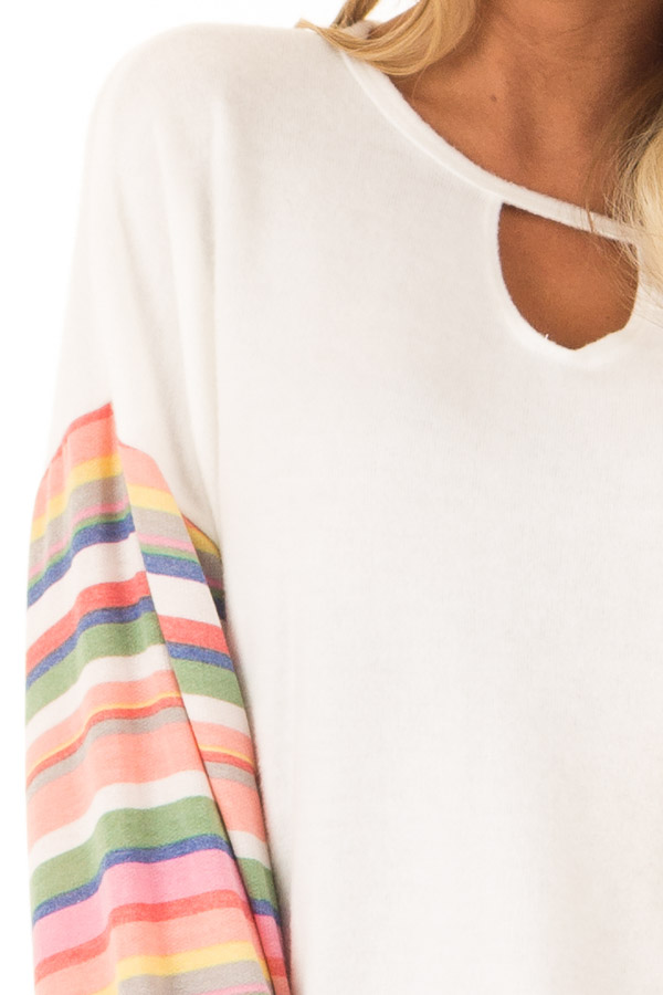 Off White Top with Keyhole Detail and Rainbow Long Sleeves detail