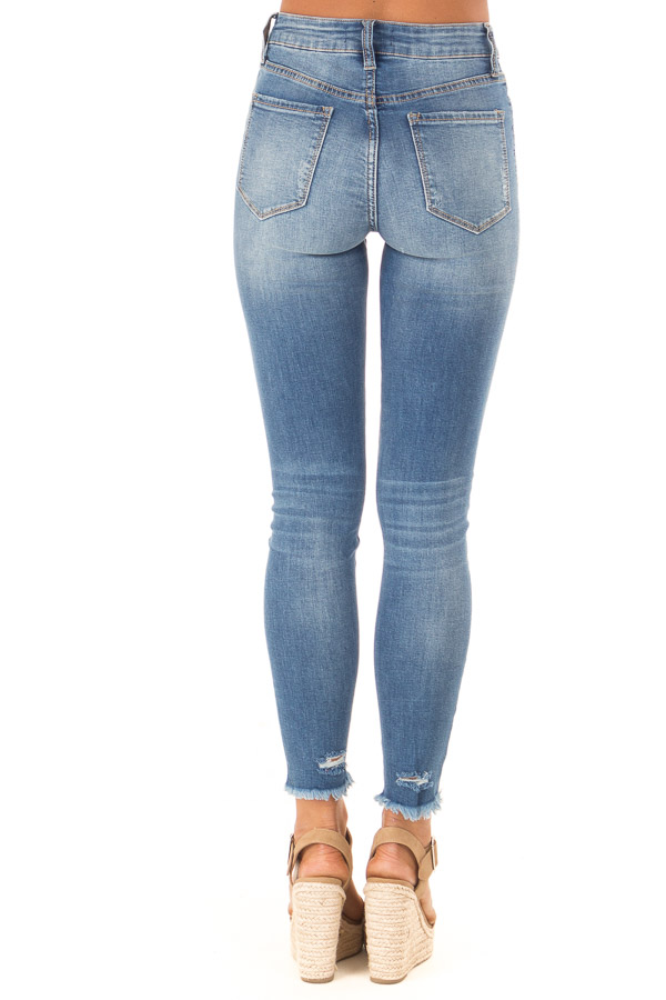 Medium Wash Mid Rise Skinny Jeans with Frayed Details back view