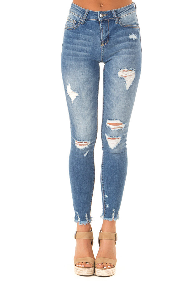 Medium Wash Mid Rise Skinny Jeans with Frayed Details front view