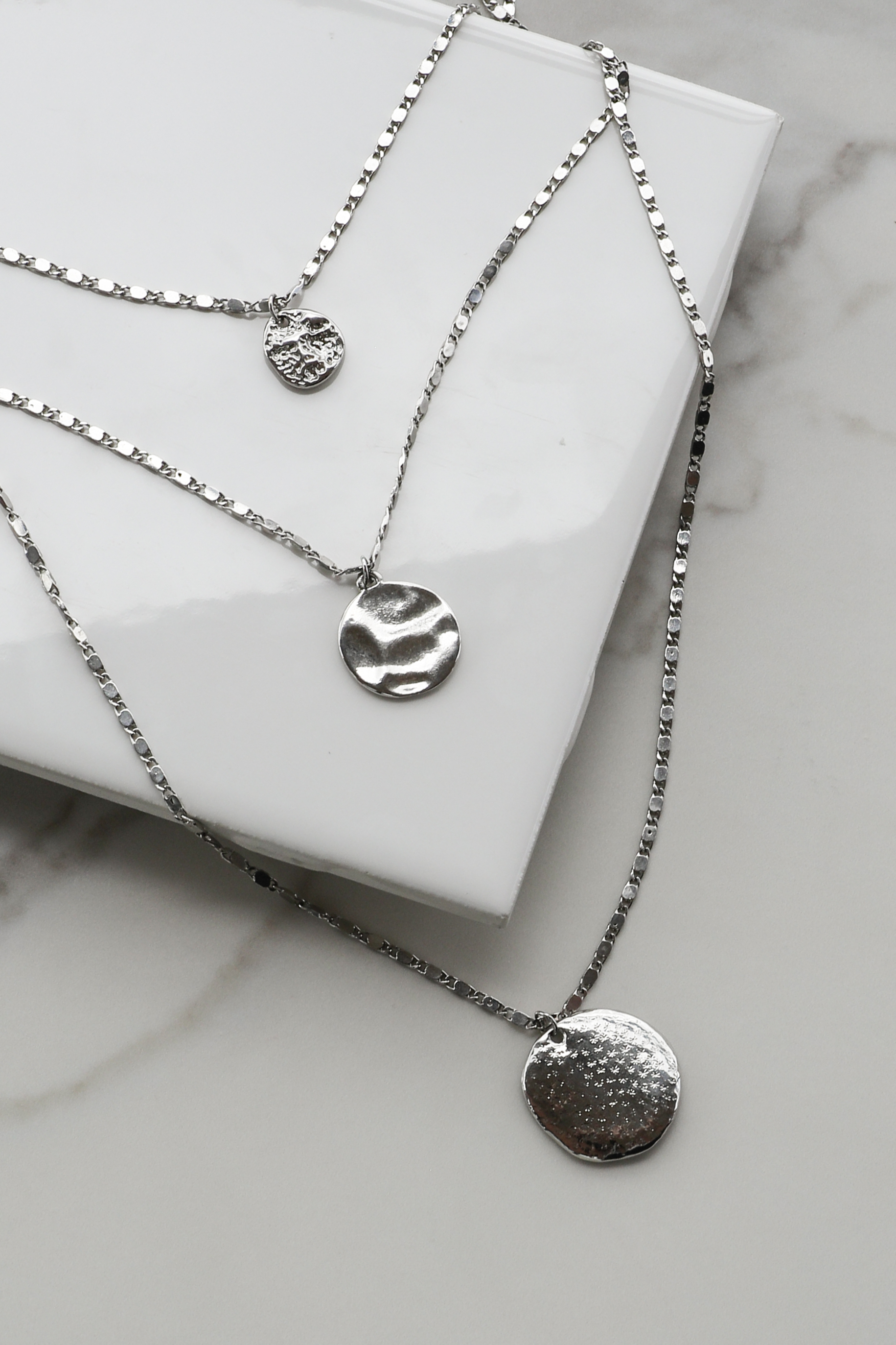 Silver-Layered-Textured-Necklace-with-Coin-Pendants