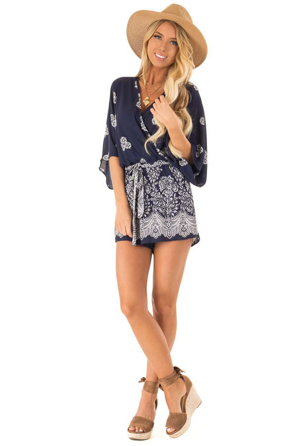 Navy Surplice Romper with Floral Print and Front Tie front full body