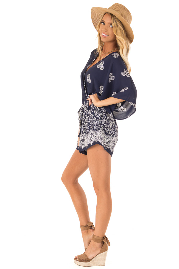 Navy Surplice Romper with Floral Print and Front Tie side full body
