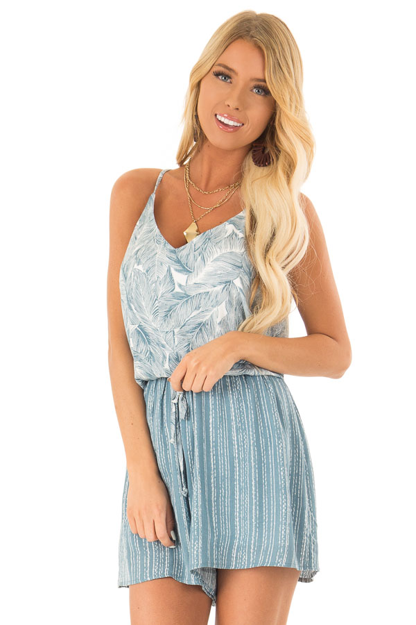 Aqua and Pearl Romper with Tropical Print Detail front close up