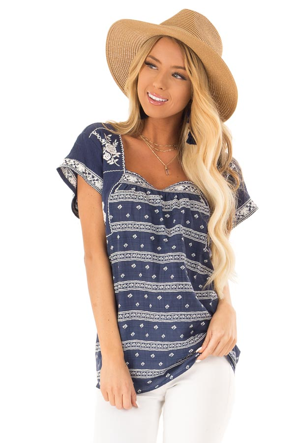 Navy and Ivory Print Peasant Top with Embroidered Details front close up