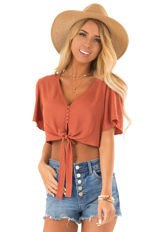 Burnt Orange Short Sleeve V Neck Button Up Crop Top with Tie front close up
