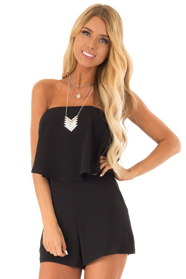 Obsidian Sleeveless Romper with Ruffle Overlay and Pockets front close up