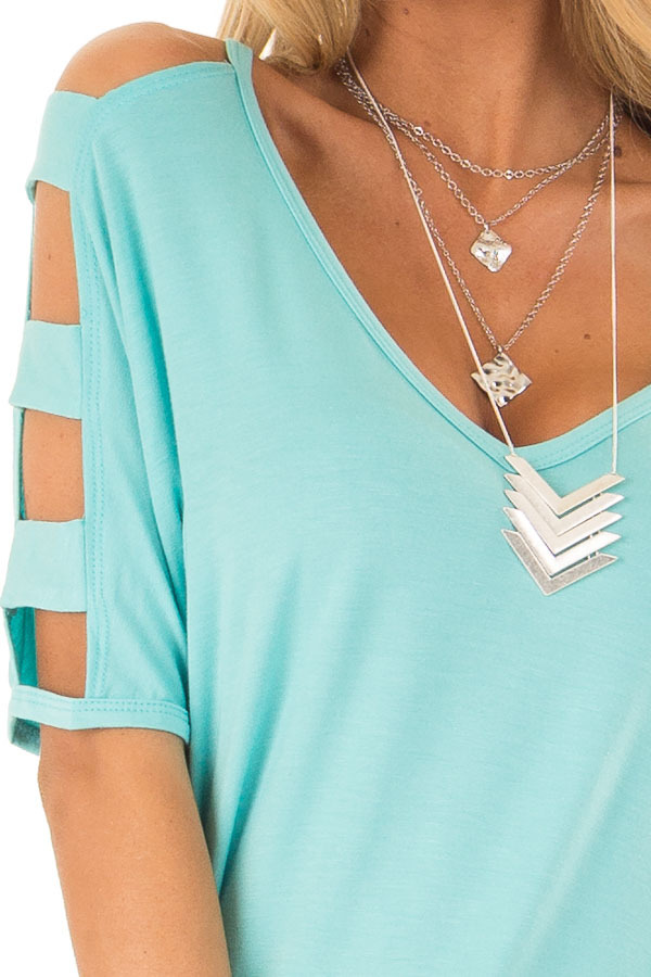 Aqua Blue 3/4 Ladder Cut Out Sleeves Top with Ruched Sides detail