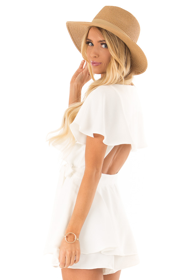 Ivory V Neck Surplice Romper with Ruffle Details and Tie side close up