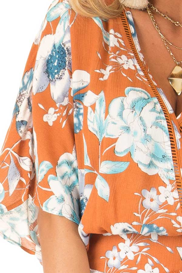Ginger Romper with Surplice Front and Floral Print detail