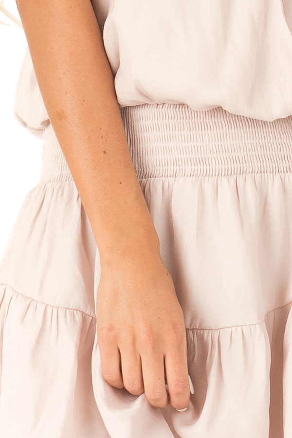 Eggshell Surplice Sleeveless Mini Dress with Smocked Waist detail