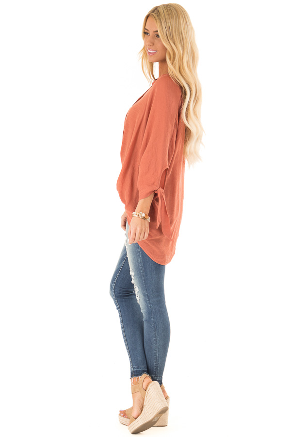 Burnt Orange Button Up 3/4 Sleeve Top with High Low Hemline side full body