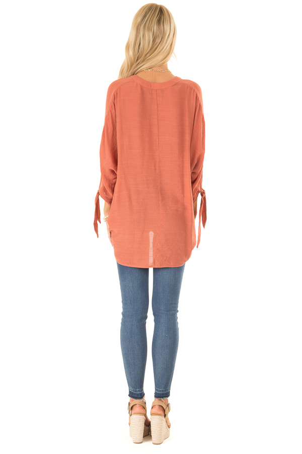 Burnt Orange Button Up 3/4 Sleeve Top with High Low Hemline back full body