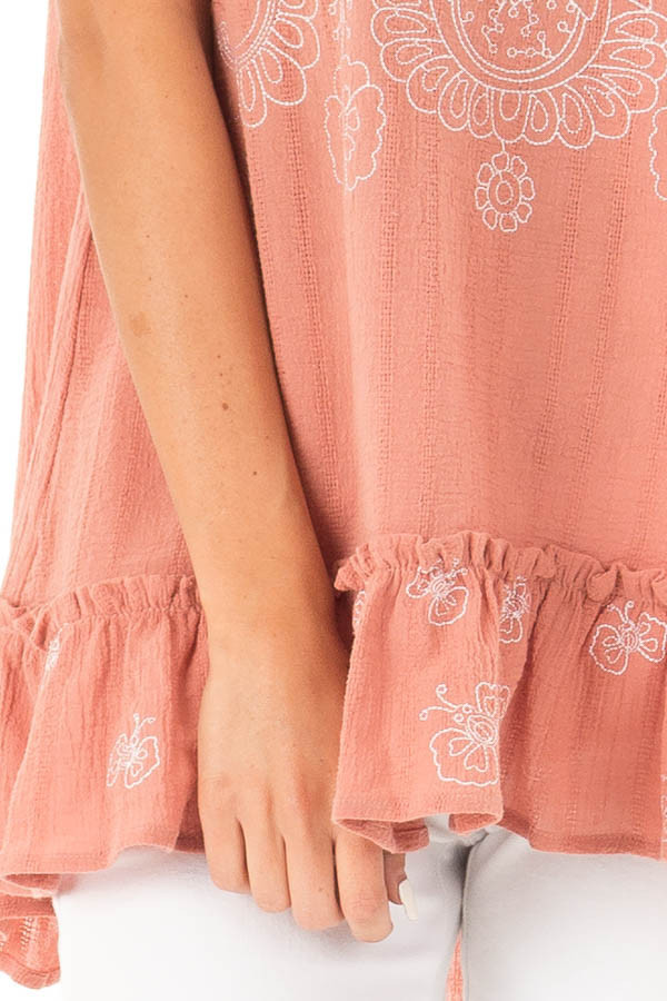 Salmon Sleeveless Top with Floral Print and Ruffle Hemline detail
