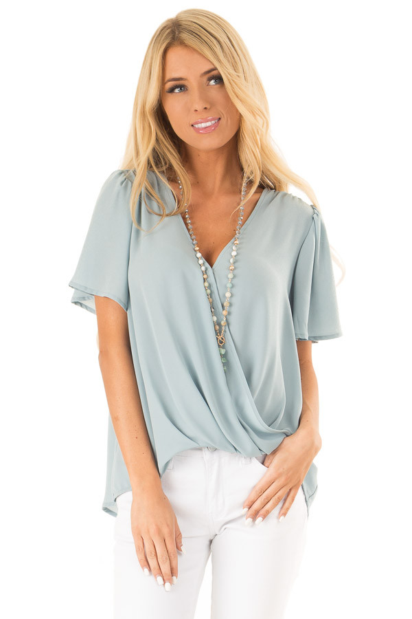 Dusty Sage V Neck Crossover Top with Bubble Hem front close up