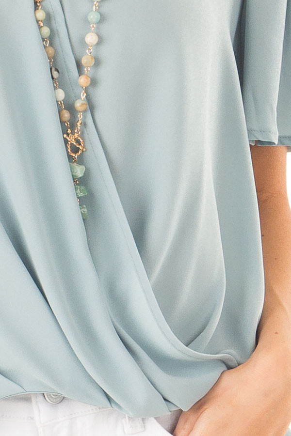 Dusty Sage V Neck Crossover Top with Bubble Hem detail