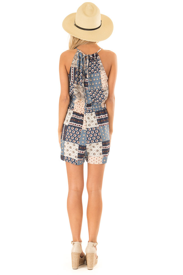 Dark Baby Blue Patterned Patch Romper with Tassel Tie Detail back full body
