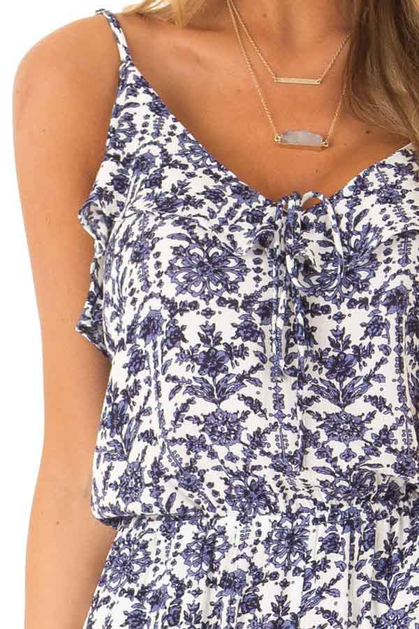 Dusty Blue and Pure White Floral Romper with Ruffle Details detail