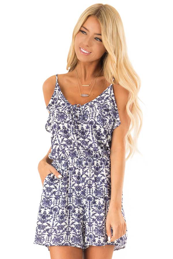 Dusty Blue and Pure White Floral Romper with Ruffle Details front close up