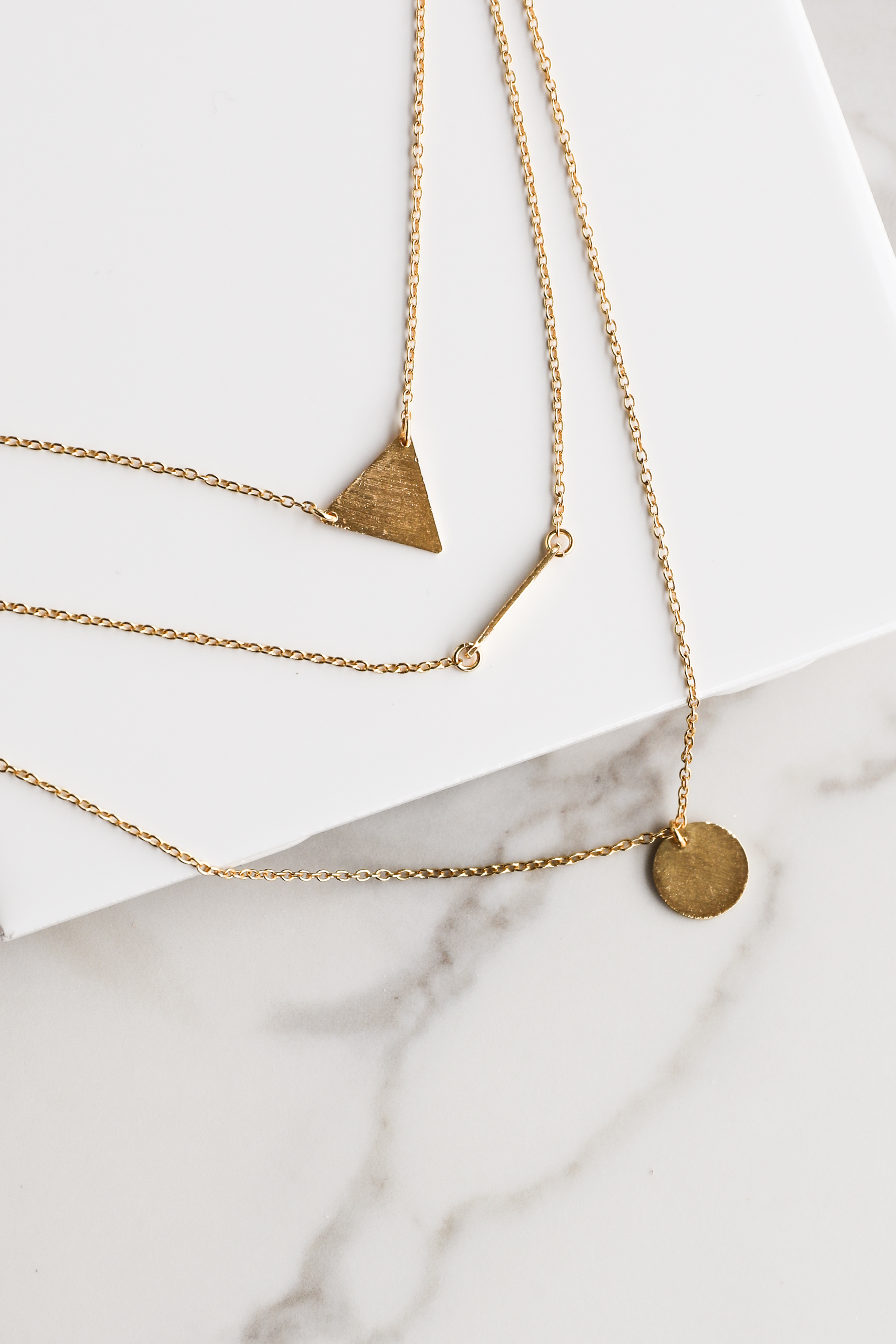 Gold Layered Necklace with Geometric Pendants