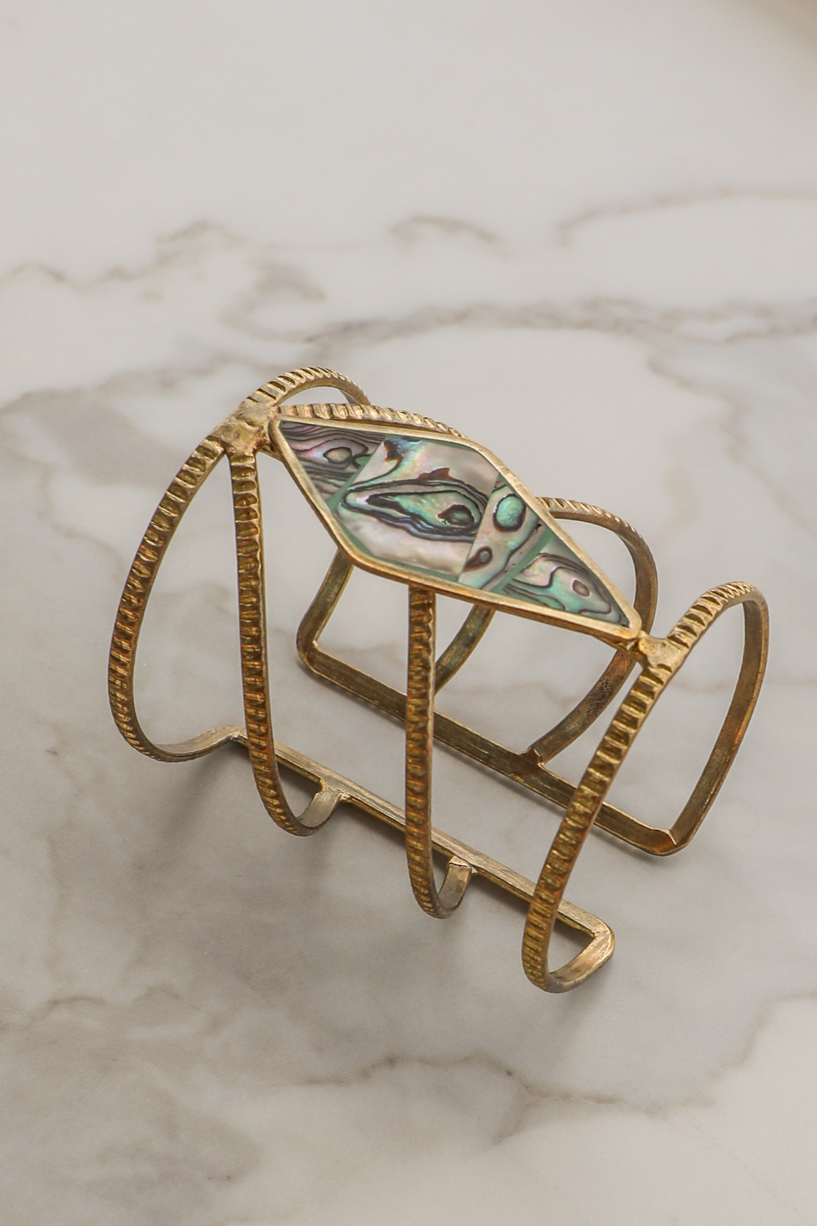Gold Cuff Bracelet with Diamond Shaped Gemstone Detail