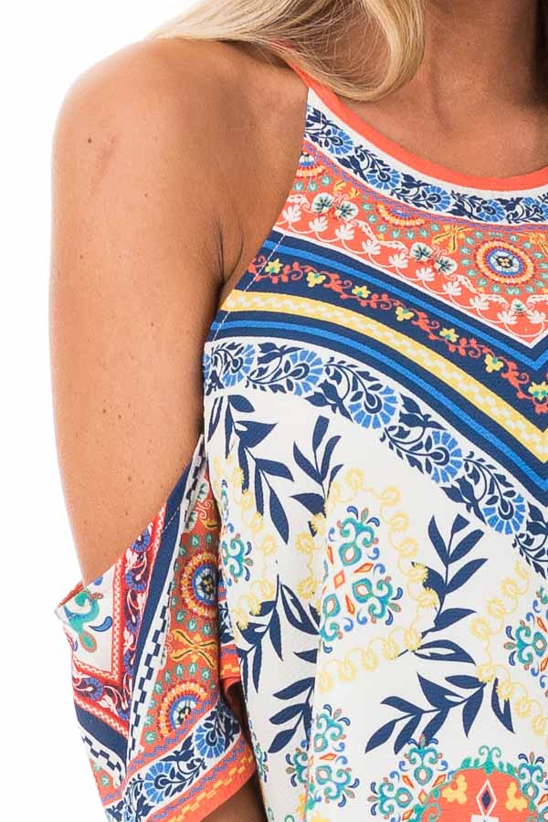 Ivory and Tangerine Leaf Print Top with Cold Shoulders detail